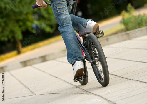 young biker riding a bmx bicycle