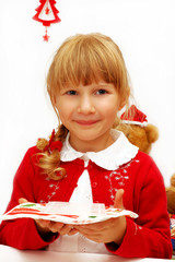 little girl with christmas eve wafer on plate