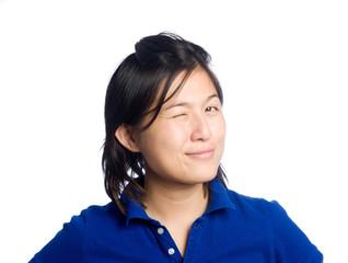 Asian girl winks in studio