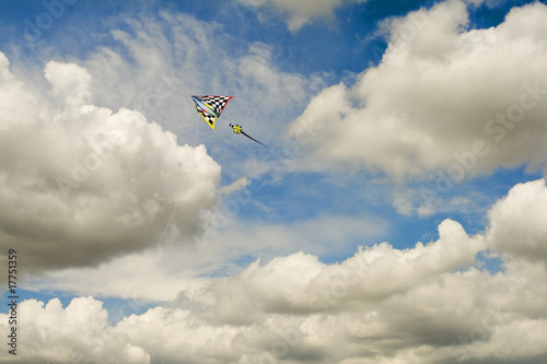 Multi-color Kite In Cloudscape and Blue Sky