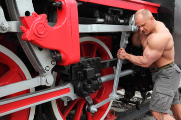 athlete checks locomotive condition