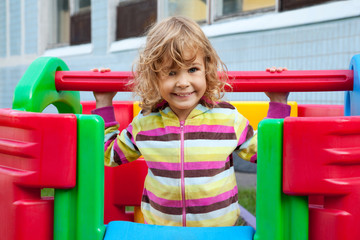 little smiling child playing outdoors