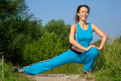 beautiful slim woman stretching outdoors