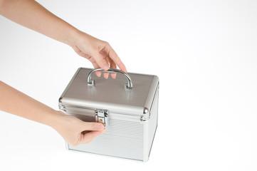 hand closing the box