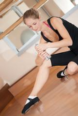 Tired ballerina with bottle