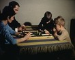 Family playing a party game vintage