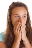 teen girl covering mouth