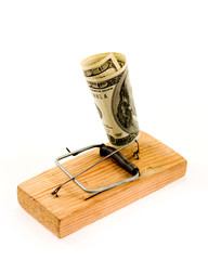 dollar banknote in a mousetrap