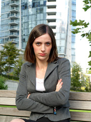 Upset young professional businesswoman