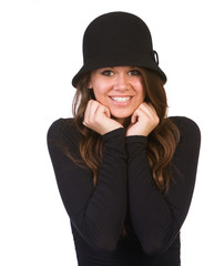 Portrait of teenage girl smiling and wearing hat.