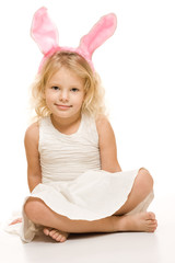 Smiling little girl with pink ears