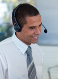Businessman with a headset on in a call center
