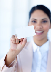 Ethnic businesswoman holding a white card