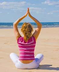 Girl Exercising Yoga on a beach