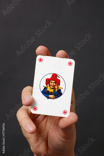 Joker card in hand
