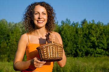 Young Women with basket on glade