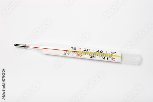 glass thermometer with red indicator showing 36.9 degrees