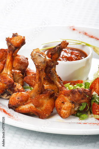 chicken wings with hot spicy barbecue sauce.