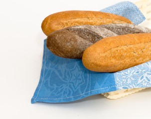 Breadbasket with bread on a white background