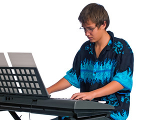 Teenager plays classical music on a keyboard