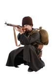Russian Cossack points a rifle in squatting position.