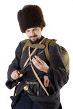 Russian Cossack inspecting a poniard.
