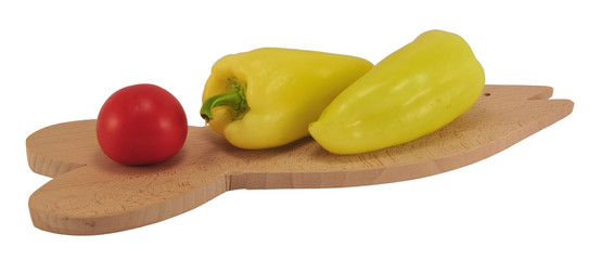 Tomato and peppers on cutting board