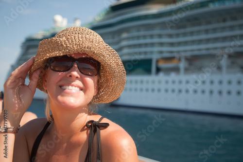 Leinwandbild Motiv Beautiful Vacationing Woman with Cruise Ship