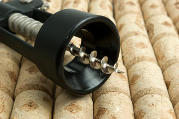 Close-up corkscrew on wine corks background