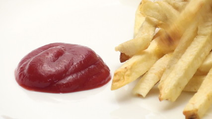 French fries dippend in ketchup series - HD