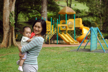 mother and baby at playground