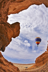 The balloon flies above a picturesque canyon