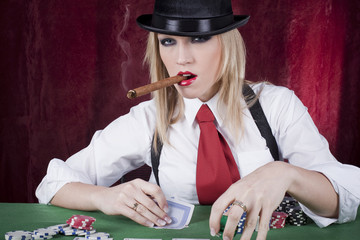 beautiful blond playing cards in a casino