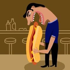 Hombre comiendo un gran perrito caliente