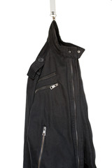 Abstract: a black jacket hanging on a snap-hook, studio shot