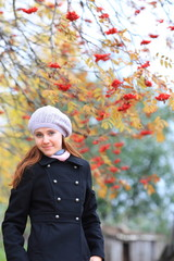 young woman posing in the fall