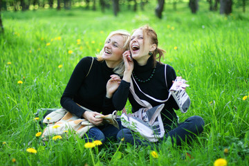 girls in park talking by phone