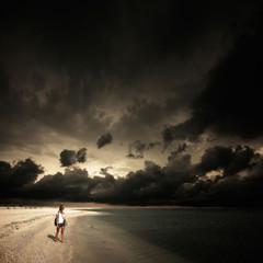 little girl under the dark sky