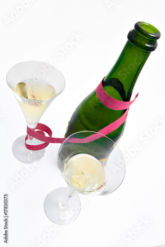 Two  champagne glasses and bottle with  providing