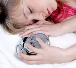 Girl  in bed with alarm clock