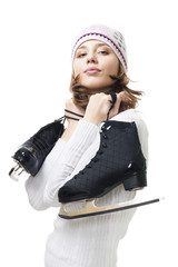 Positive woman hold ice skates