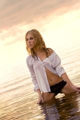 young beautiful girl in a wet shirt