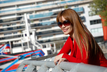 woman in sunglasses on a city background