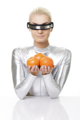 Cyber woman with oranges