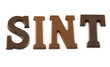 Word Sint in chocolate letters over white background