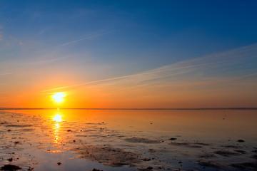Sunrise at the sea coastline