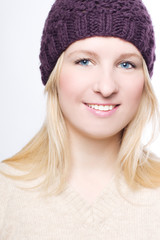 portrait of a beauty woman in a warm hat