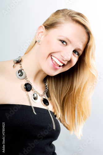 Portrait of funny young woman in black dress