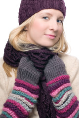 portrait of a beauty young woman in a warm hat and gloves
