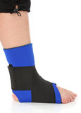 Foot with an ankle brace, over white poster